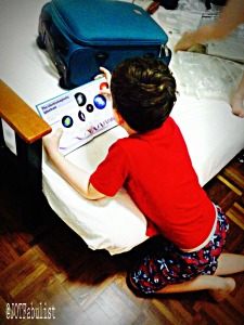 Fig 4: By midday, P had progressed to reading in his pyjamas as T jumped naked on the bed.